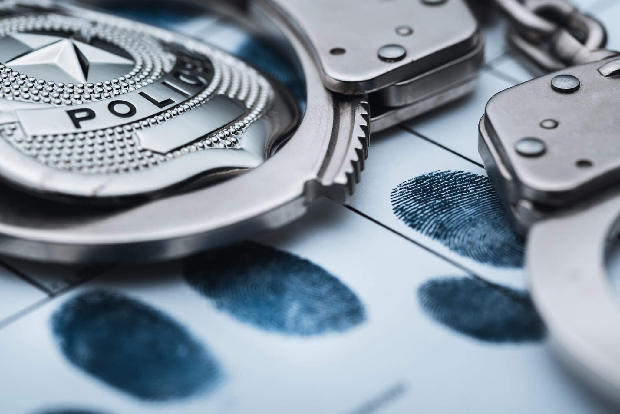 Image of police handcuffs and set of fingerprints | 2019 Police Training | Lathrup Village Police Officers | Paw Paw Police Officer career opening