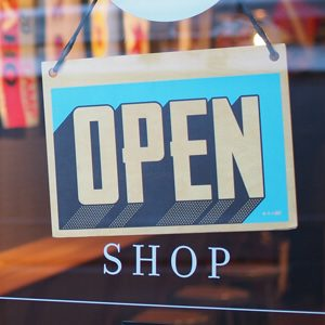 Image of an open sign at a store | RPA Lifestyle Creep Article