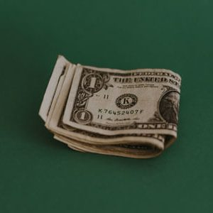 Image of one dollar bills | Retirement Income | Saving Early