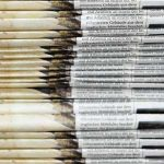 Stack of two sets of newspapers | COVID-19 News Coverage