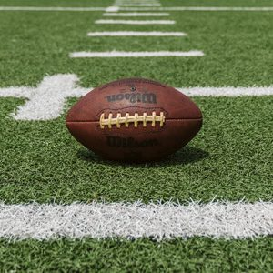 A football on a football field | Protecting our Officers