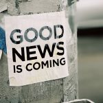 Good News is Coming sign on pole | 2020 Year In Review
