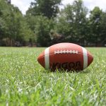 Football laying on green grass | NFL Response