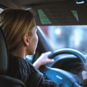 Teen sitting behind the steering wheel in a car | Traffic Stop Guidelines